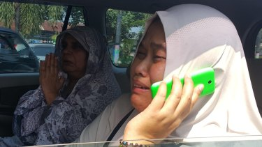 Condemned man Zulfiqar Ali's distraught wife, Siti, after learning her husband will be executed on Thursday night.