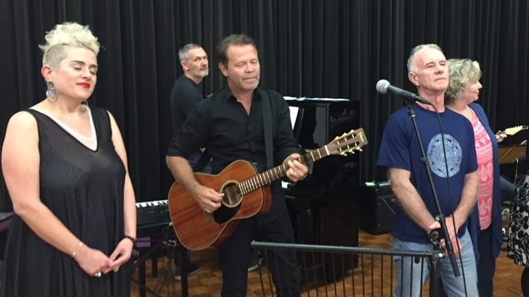 Musicians including Katie Noonan and Troy Cassar-Daly prepare for the benefit concert for Brisbane singer-songwriter Carol Lloyd at QPAC.