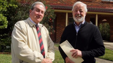 Ian McCormack (left) and Bruce Langley say the government's rush to privatise Land, Property and Information caused the massive error.