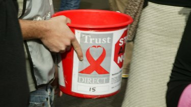 A charity collector on a Sydney street.