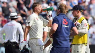 Safety first: Joe Root hydrates during one of the many drinks breaks on day four of the Test played in extreme heat.