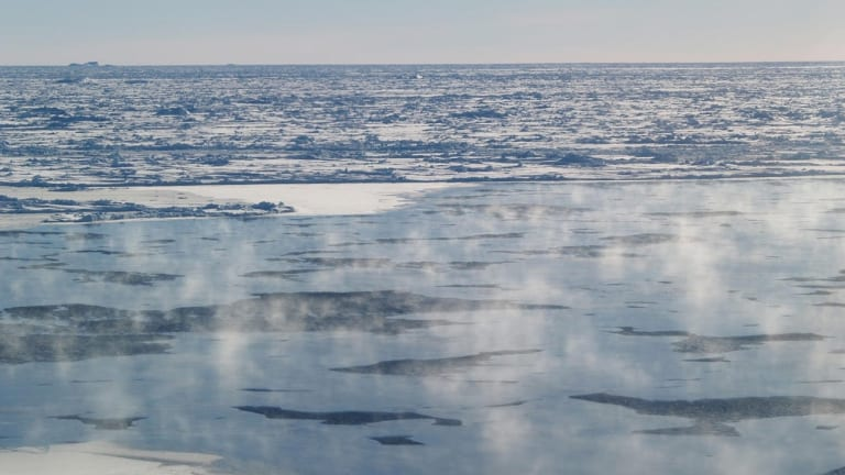 Water vapour rises off the Antarctic ice sheet as a rare hole opens in the Antarctic winter sea ice.