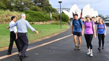 """Indonesian President Joko Widodo and Prime Minister Malcolm Turnbull conduct """"morning walk diplomacy"""" as they stroll through the Royal Botanic Garden in Sydney on Sunday."""