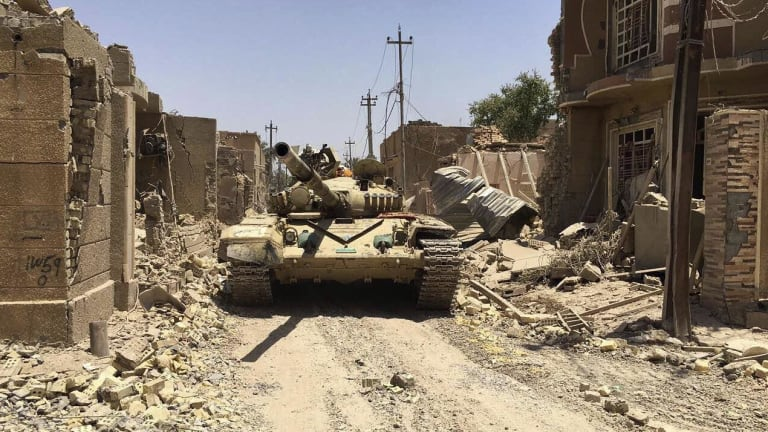 Iraqi security forces in Fallujah on June 26 after defeating Islamic State militants.