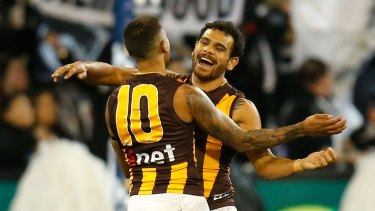 d4ad0cbbcb52 Bradley Hill and Cyril Rioli of the Hawks rejoice after a goal.