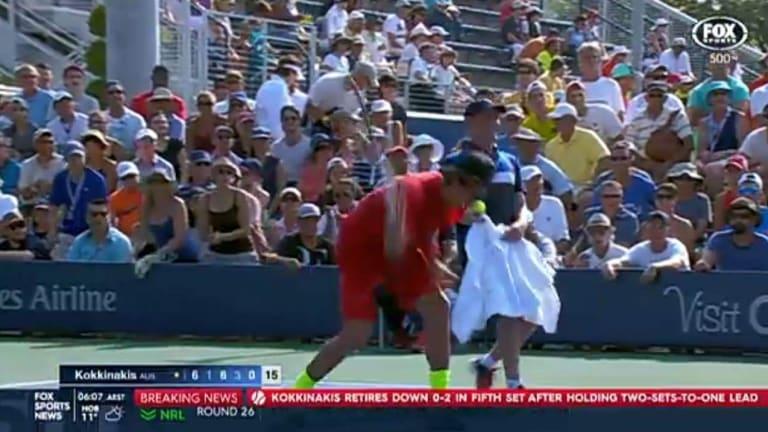 Thanasi Kokkinakis smashes his racquet.