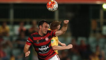 Airborne: Mark Bridge of the Wanderers and Jacob Poscoliero of the Mariners compete for the ball.