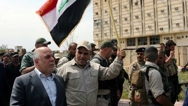 Iraqi Prime Minister Haider al-Abadi tours the city of Tikrit after it was retaken by the Iraqi security forces.