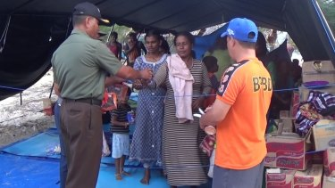 Sri Lankans receive supplies from Indonesia while at the tent camp.
