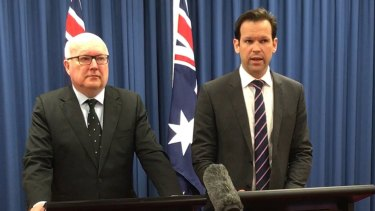 Former federal resources minister Matt Canavan (right) announces he has quit cabinet amid doubts about his citizenship on Tuesday.