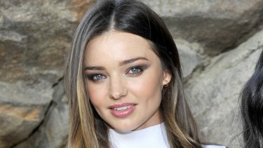 Clothes off: Model Miranda Kerr.