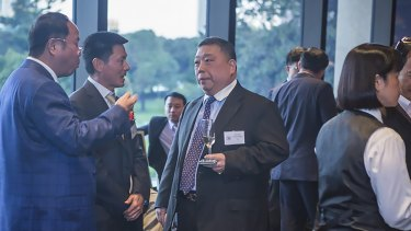 Huang Xiangmo (far left) and NSW state MP  Ernest Wong at the 2014 unveiling of an Australian Guangdong Chamber of Commerce plaque at NSW Parliament.