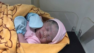 Cambodian Lux Clinic posted a photo of a minutes-old baby girl on Facebook following Hour Vanny's cesarean section on August 25. The surrogate mother confirmed the girl was the baby she carried.