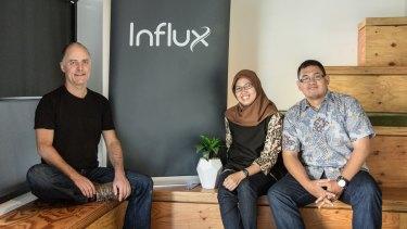 Influx co-founder Leni Mayo, with employees Kandianawati and Basilius Prabawa.