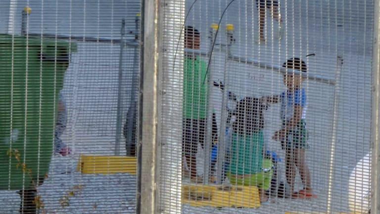 Children play near the Regional Processing Centre on Nauru.