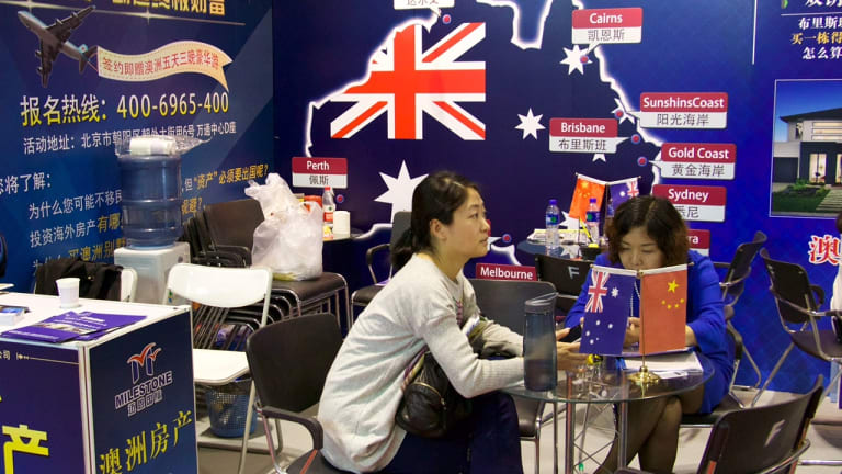 Australia booths at a Beijing property fair, promoting the chance to buy on the Sunshine Coast.