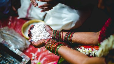 Puffed rice is added to the fire to ensure prosperity.