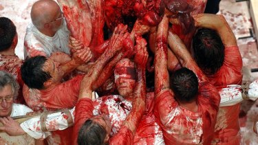 Participants in a Hermann Nitsch performance art piece at Burgtheater in 2005.