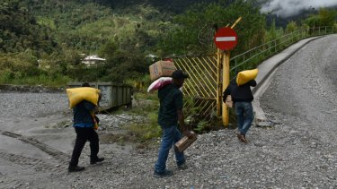 Papuan villagers take food back to their villages.
