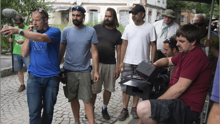 Director Wayne Blair (in black cap) on set with the crew of <i>Septembers of Shiraz</i>.