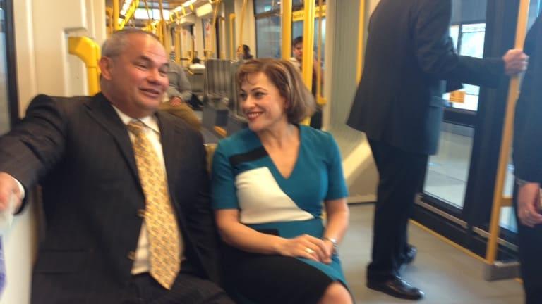 Gold Coast Mayor Tom Tate and Queensland Deputy Premier Jackie Trad take a ride on light rail.