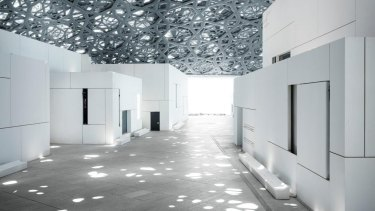 The latticed steel roof creates a 'rain of light' inspired by the shadows of palm trees.