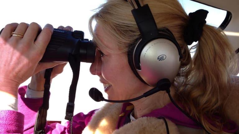 Johnston flies over the Pilbara, copiloting a small plane.