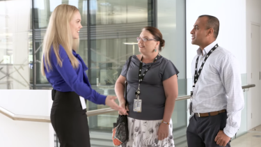 Claire talks with colleagues about her appetite for paleo pear and banana bread in the Department of Finance ad.