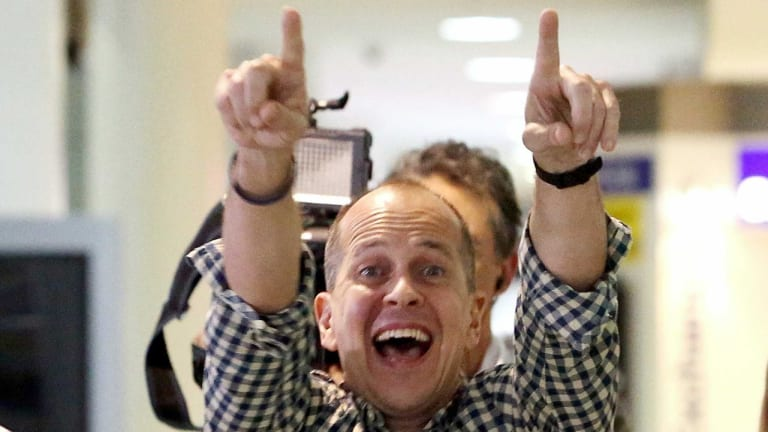 Australian journalist Peter Greste reacts upon his return home at Brisbane International Airport.