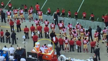 Not backing down: Colin Kaepernick has said he will keep sitting during the US anthem.