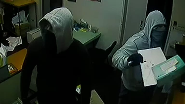 Police are looking for two men in connection with a series of post office break and enters.