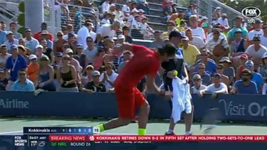 Thanasi Kokkinakis throws his racquet into the ground in frustration.