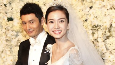 Angelababy with Chinese actor Huang Xiaoming at their wedding in Shanghai.