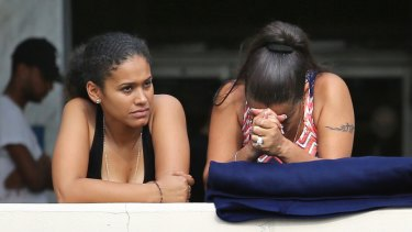Grieving friends and family of victims of the mass shooting.