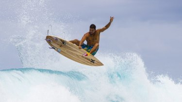 Michel Bourez, 2014 ASP World number five, on a Firewire wooden board