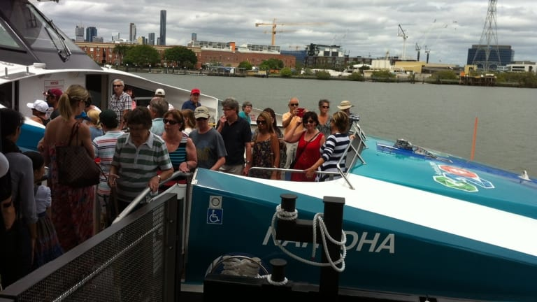 Hundreds of residents look through one of the city's new CityCats, Nar-DHA, at the opening of the new Bulimba CityCat and ferry terminal.