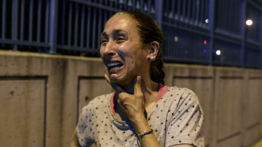 A woman stands and cries outside Istanbul's Ataturk airport after the explosions.