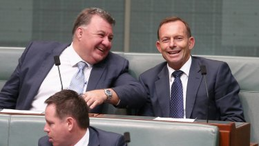 Mr Kelly in discussion with former prime minister Tony Abbott  during question time in November.