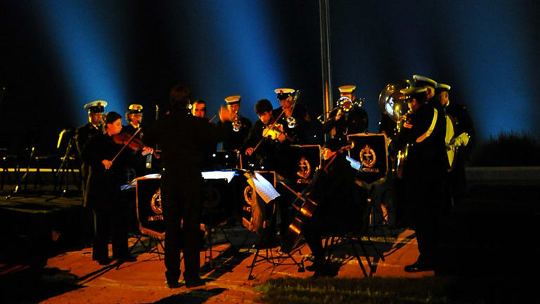 Chris Latham conducting a movement from The Gallipoli Symphony at Anzac Cove before the Dawn Service.