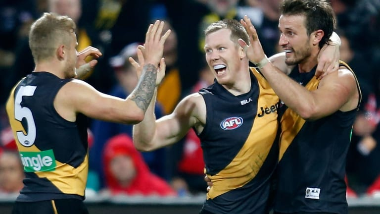 Brandon Ellis, Jack Riewoldt and Ivan Maric of the Tigers celebrate.