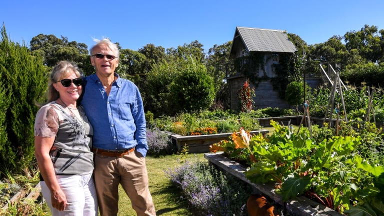 Warwick and Sue Forge in their garden in Merricks North. The pair are looking for new owners for the Australian Landscape Conference.