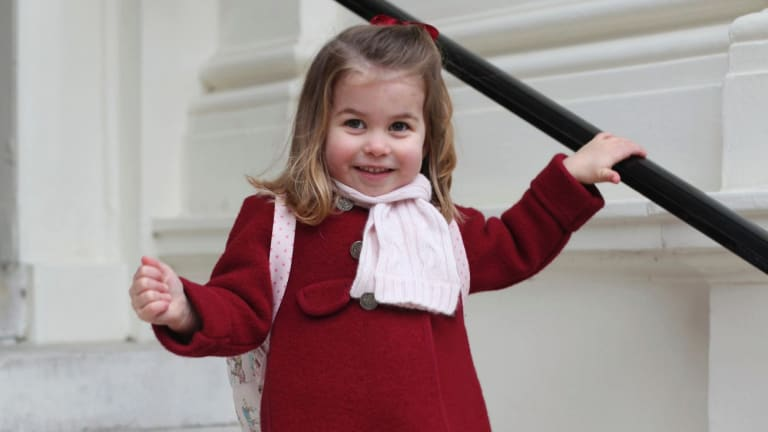 Princess Charlotte smiles as she prepares for her first day of nursery.