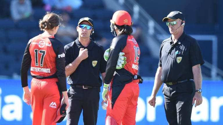 Confusion: Renegades players Amy Satterthwaite and Emma Inglis talk to the umpires.