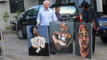 "Bali nine lawyer, Julian McMahon, with three recent paintings by Myuran Sukumuran, among them one marked ""Self Portrait, 72 hours just started"" as Sukumuran began the countdown to his execution."