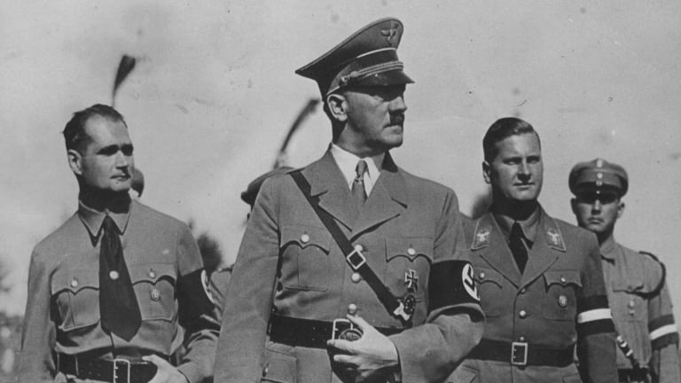 Adolf Hitler with some of his deputies. Rudolf Hess, left, and Baldur V. Schirach, right, in 1936.