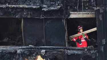 A London firefighter inside the charred Grenfell Tower.