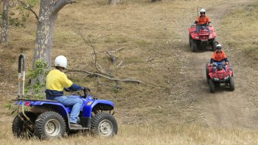 A coroner recommends children be banned from riding adult-sized quad bikes in Queensland.