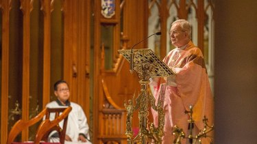 Monsignor William Mullins leads mass at St Mary's Cathedral.