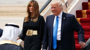 US President Donald Trump and first lady Melania Trump arrive at a welcome ceremony at the Royal Terminal of King Khalid International Airport.