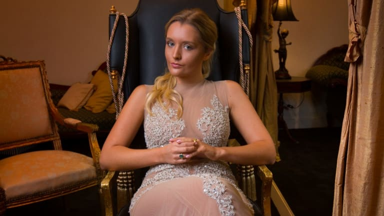 Zofia Krasicki tries on evening gowns at Oglia-Loro Couture in South Yarra for le Bal in Paris.